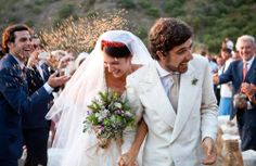 Marta Ferri and Carlo Borromeo escape through a shower of wheat. The bride's bouquet of wildflowers, fennel, rosemary, and mint was picked by the groom shortly before she walked down the aisle. -- Photograph by Marcello Serra and Nicola Cipriani