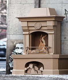 German artist Bartek Elsner has taken the simple cardboard and transformed it into street art installations of cameras and a fireplace. Cardboard Sculpture, Cardboard Paper, Cardboard Furniture, Cardboard Crafts, Cardboard Design, Cardboard Castle, Paper Clay, Origami Architecture, Cardboard Fireplace