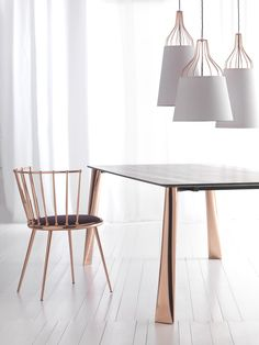Chair, table and chandeliers in copper. See more Copper inspirations at http://www.brabbu.com/en/inspiration-and-ideas/ #CopperLighting #CopperDesign #CopperDecoration