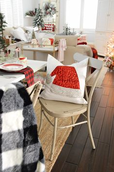I always find the perfect things to make our house & holiday feel extra special at @HomeGoods - like this sequined Santa hat and B&W buffalo check faux fur throw! Christmas Dining Room | Eclectic cottage farmhouse farm table in red, black and white. #sponsored pin
