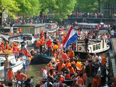 "Koninginnendag (Queen's Day), Netherlands: April 29 or 30  This is a national holiday and a ""free market"" day, so everyone sells everything on the streets. There are games, concerts, performances, and parties on boats in the canals. Learn more about Koninginnendag."