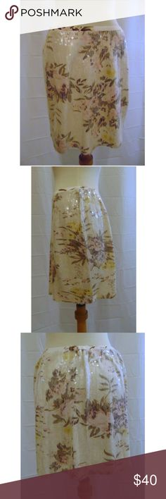 Chan Luu floral print sequin mini skirt Sz S back zipper elastic in waistband 100% viscose  dry clean waist 28 to about 31 inches hip 38 inches length 15 1/2 inches All noticed Flaws will be included in the listing  Items are stored in a smoke free, pet friendly home Chan Luu Skirts Mini