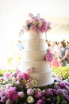 Bride's cake with married initials made of icing! And perfectly topped with flowers.