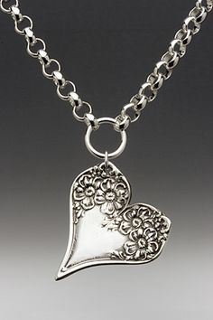vintage heart pendant made from the ends of two spoons florentine pattern