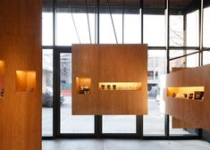The units are made of steel and contain small nooks for displaying unlit candles, incense, perfume and related merchandise. Each nook is illuminated with a linear LED.