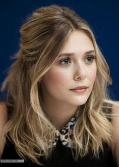Elizabeth Olsen with beach waves and pretty day makeup - book the look now at…                                                                                                                                                                                 More