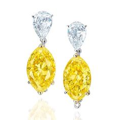 Moussaieff. This 6.76 ct and 6.17 ct vivid yellow fancy and beautiful pear shaped white diamond earrings sold at #christiesjewels Hong Kong in June.