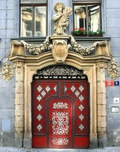 This red door and surround in Prague is magnificent! Photo by Emil Dam via flickr... by echkbet