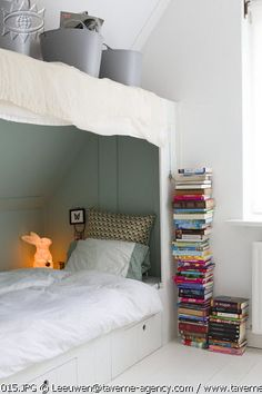 Love this cozy space with under-bed drawers and storage space up top.