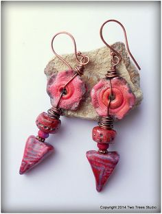 Lightweight RED earrings featuring artisan lampwork disks and polymer clay triangles.  By Two Trees Studio, $31.00.