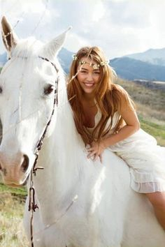 I'm gonna ride a white horse down the aisle and it's gonna have a bridle of wildflowers lolol (PS, is that Miley Cyrus?)