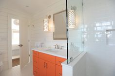Nina Liddle Design - bathrooms - Parker Pendant Wall Sconce, shower pony wall, subway tile, white subway tile, tiled shower niche, shiplap bathroom walls, wood planked bathroom walls, paneled bathroom walls, orange sink vanity, modern orange sink vanity, nickel cabinet pulls, white vanity counter, rectangular porcelain sink, built in polished nickel medicine cabinet, white and orange bathroom, white hex floor tile, white hexagonal floor tile, geometric wall sconce, polished nickel geometric…