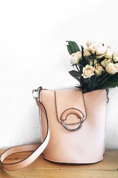 Our tan Italian leather bucket bag is a great carry-all bag. Emily Jenny of Stiletto Beats uses it to carry some fresh blooms for spring | Banana Republic