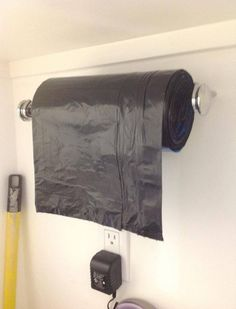 Paper towel holder to hold garbage bags! Great for garage - Genius!!