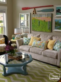 Colorful Lake House tour filled with tons of great DIY ideas! Love the gallery wall! Coffee table