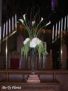 Wedding Flowers - Altar Arrangement featuring white calla lilies accented with hydrangea and hanging amaranthus