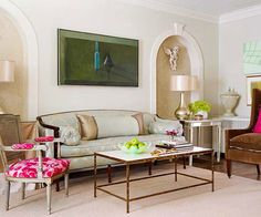 To ensure seamless transitions between spaces old and new, the designer borrowed inspiration from the home's existing detais, such as its original arched doorways. Here, the living room sofa nestles between recessed niches coated in lustrous Venetian plaster.