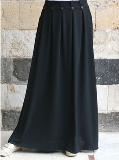 Made from a soft crepe fabric, crafted with inverted pleats for flare and movement, and adorned with beautiful decorative wooden buttons, this might just become your favorite skirt. Long Skirt Outfits, Long Maxi Skirts, Mini Skirts, Muslim Wedding Dresses, Dress Wedding, Wedding Bride, Moroccan Dress, Islamic Clothing, Hijab Dress