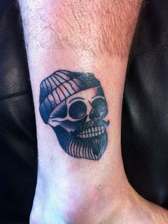 Traditional Skull tattoo with a twist, done by Alex Newey at Tattoo & Co in…