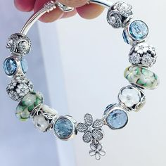 Pandora bracelet with blue and green. Great color combo idea.