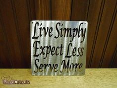 """Live Simply Expect Less Serve More Metal. This Metal Craft is about 6"""" wide and 6"""" tall and costs $8.99."""