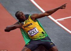 Showman: Usain Bolt celebrates his victory by striking his customary lightning…