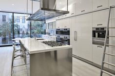 Part of a full renovation in a single-family townhouse on the Upper East Side, this gorgeous #ArclineaNY Dream Kitchen features our Italia and Artusi styles in solid acrylic and stainless steel, with countertops in white glass. An architectural aspect, our Convivium hood adds structural elegance when coupled with the sleek Miele appliance package. City living at its finest.