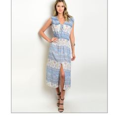 Light Blue Floral Midi Dress Perfect summer dress! This lightweight midi dress has a daring front slit and a boho chic vibe. It is made of 100% rayon and comes in small, medium, and large (see separate listings). Large- Bust 36 in., Length 48 in. Doo B Doo B Dresses Midi