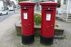 Royal Mail is one of the most famous things in the UK.    Red mail boxes are everywhere on the UK's road side ,even under the trees or on the wall.    These two are the biggest ones in Lyndhurst. If you've got a mail a bit urgent, sent your mail from here. It'll be quicker to your receiver.