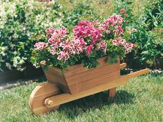 """DIY PROJECT-WHEELBARROW PLANTER.  Size - 40"""" x 10"""" x 15"""" highWheel turns, to move planter easilyComplete list of materialsStep-by-step instructionsFull-size traceable pattern"""