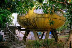 Explore a mysterious 'UFO village' on the shores of the Taipei Basin, where decaying Venturo and Futuro houses stand shoulder to shoulder in dereliction.