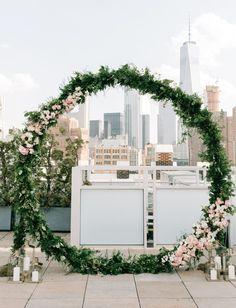 modern giant floral wreath wedding ceremony backdrop new york city skyline nyc