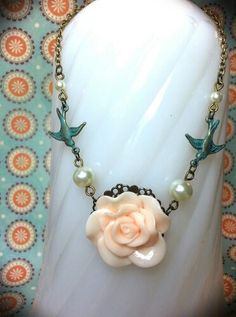 Antique bronze necklace w/ cabochon flower, teal patina birds and creamy glass pearls | Two Birds Creations on Facebook
