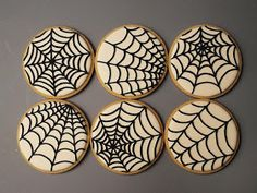 Spider Web cookies for Halloween. Visit for cookie decorating tutorials!
