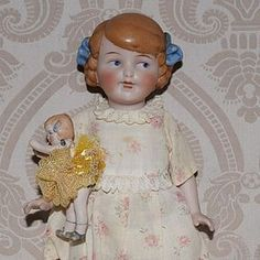 German All Bisque Girl with Her Own All Bisque Doll - Lynette Gross Antique Dolls, LLC #dollshopsunited