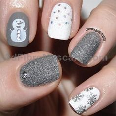 White and silver themed Christmas nail art. Be creative and combine white and gray glitter colors on your nails. Add simple details like snowflakes, polka dots and a snowman to make it stand out more.