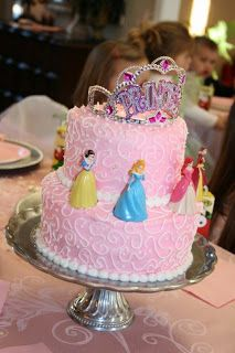 double layer, pink icing, white swirls, princess polly pockets on top and crown.