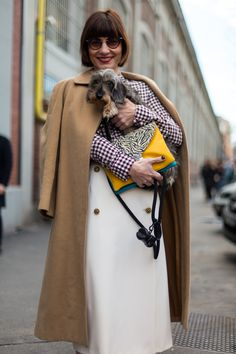 Fashion Week Street Style. Accessorising hound with check at Milan Fashion Week Fall 2015#StreetStyle #MFW