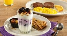 Our low-fat vanilla yogur t parfait is blended with wild Maine blueberries and fresh blackberries, and topped with our honey oat granola mix with almonds.