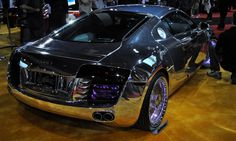see through acrylic rims... and with a chrome paint, and color changing lights in the rims, side scoops, and grills  TRON Car by West Coast Customs