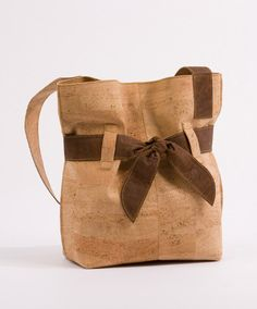This bag retails for $395.  It is made of high quality real cork fabric in Portugal.  Cork is naturally:  Water/Stain/Fade Resistant Eco-Friendly Certified Green Material Soft and as durable as leather