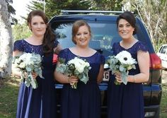 Bridesmaids navy lace dresses