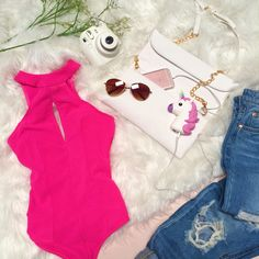 Look hot this summer in hot pink! This bold, stylish bodysuit is sure to turn heads.