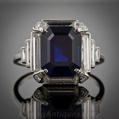 4.96 Carat Art Deco Sapphire and Diamond Ring Platinum - 1930 This magnificent, rich velvety blue emerald cut sapphire is surrounded by elegant, extra long baguette diamonds which taper and step down the shoulders in classic Art Deco style. Each prong is dotted with an additional sparkling round cut diamond.