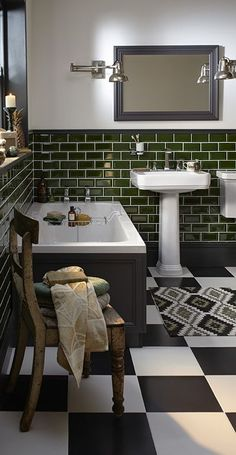 Love the dark green wall tiles with the black and white chequered floor tiles in this art deco style bathroom. Wynwood Bathroom Collection | Heritage®️️