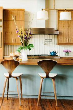 I like the midcentury look. Favorite things are the chairs and the color tones of wood cabinets and island. Not too crazy about the grain/texture of the cabinets.