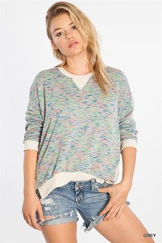 The perfect sweater to wear while enjoying hot chocolate. Against the soft grey background are dashes of blue, pink, and green. The Dolman sleeves add comfort and roominess to a soft feeling sweater. Not too heavy or thick so it's perfect for those crisp early Fall days.