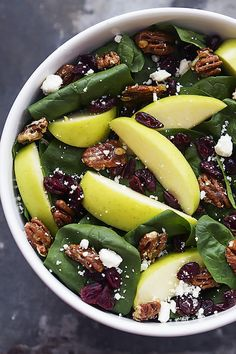 Baby spinach leaves tossed with green apples, dried cherries, feta cheese, and candied pecans - all drizzled with a sweet balsamic dressing!