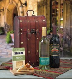 Show off your good taste in style with this vintage two bottle wine tote. The pairings will go great with the delights inside.  Gift Includes: 2011 Pig & Poke Cabernet Sauvignon, 2010 Lange Twins Sauvignon Blanc, Olive Oil & Sea Salt Crackers, and two (2) Northwoods Cheese triangles. Arrives in an Antique Wood 2-Bottle Tote with leather straps and handle. Gift Include...