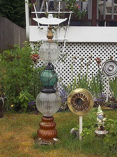 recycled glassware and lamps into garden totems and bird baths, gardening, repurposing upcycling, This one is old glass lamp bottoms witht he same treatment on top